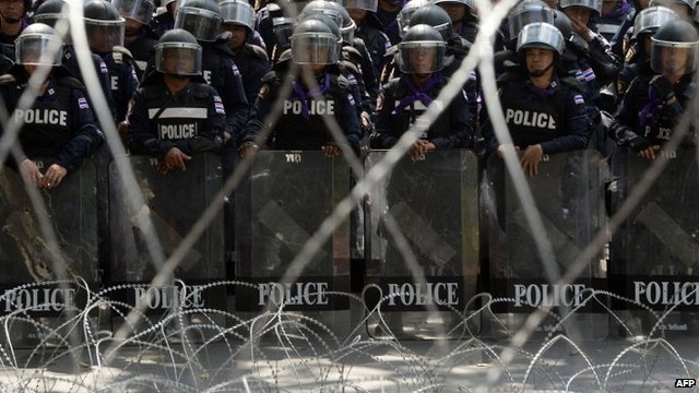Riot officers outside Thai police HQ