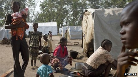 A displaced family sit in front of their tent in the grounds of Saint Antoine de Padoue cathedral in Bossangoa, Central African Republic, November 25, 2013