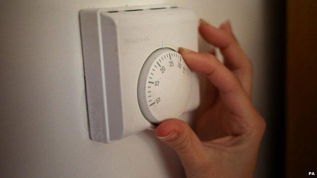 Person adjusting room temperature