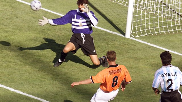 Dennis Bergkamp scores for Netherlands against Argentina at the 1998 World Cup