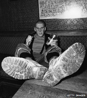 Circa 1978, a skinhead pictured in a pub
