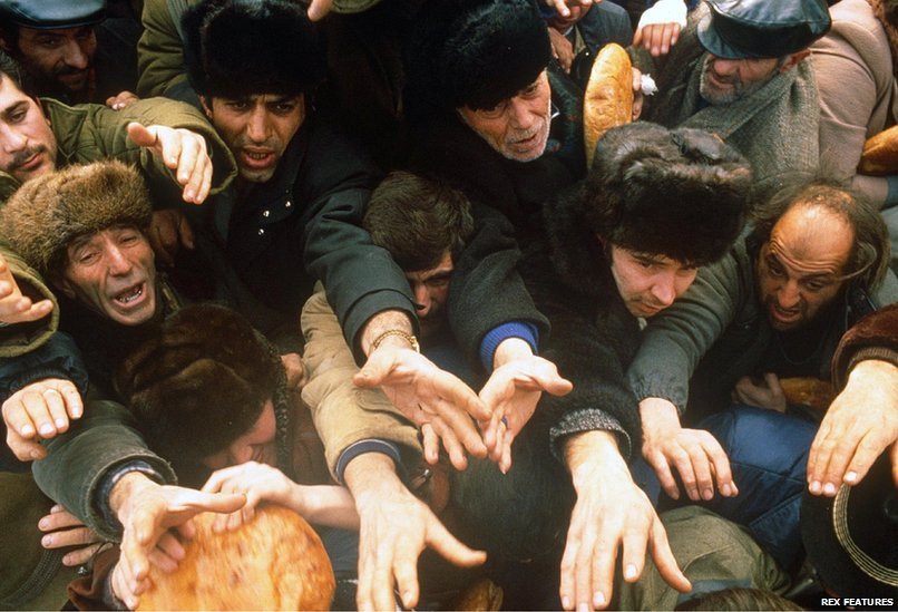 Bread is distributed to survivors after an earthquake hit Armenia, on December 7, 1988.