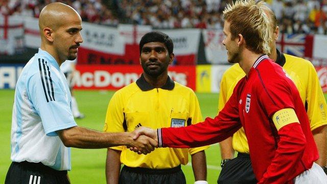 Juan Sebastian Veron and David Beckham shake hands before Argentina v England at the FIFA World Cup in 2002