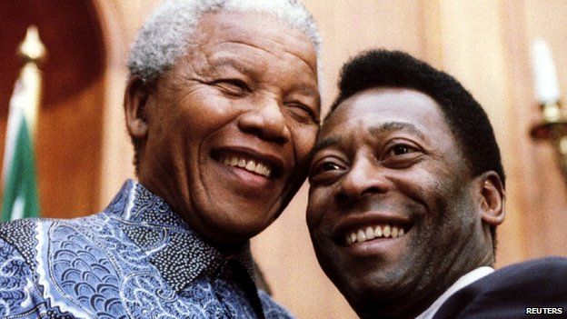 South African President Nelson Mandela (left) and Brazilian Sport Minister and former soccer player Pele smile for photographers at the Union Buildings in Pretoria on 24 March, 1995