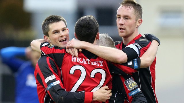 Crusaders Paul Heatley celebrates with his team-mates after scoring against Dungannon Swifts