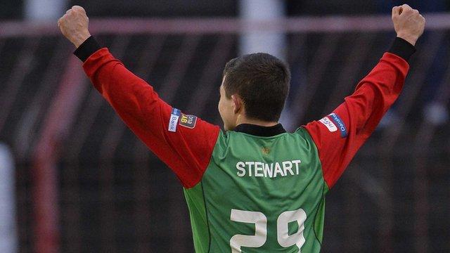 Glentoran's Jordan Stewart celebrates opening the scoring against Warrenpoint Town