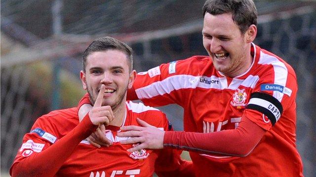 Portadown's Darren Murray celebrates scoring a penalty with team-mate Gary Twigg