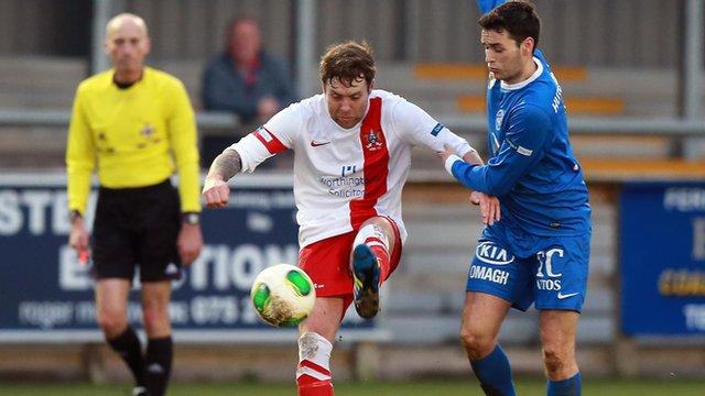 Match action from Ballinamallard against Ards