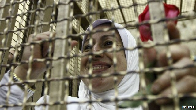 Woman with rose in Cairo court