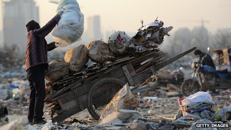 A woman scavenges for rubbish in China