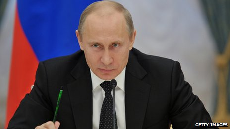 Putin speaking to a group of people