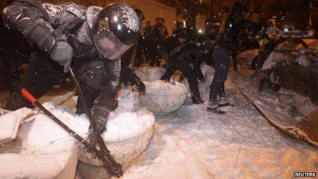 Police dismantle barricades