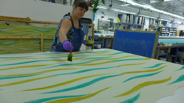 woman painting fabric