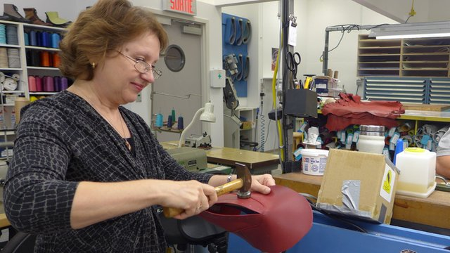 Cobbler making shoe