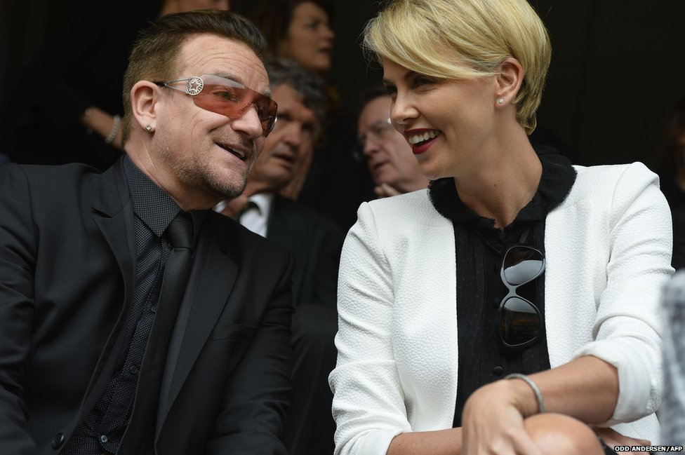 Irish band U2's lead singer Bono and South African actress Charlize Theron