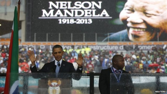 President Barack Obama addresses the crowd during a memorial service for Nelson Mandela at FNB Stadium