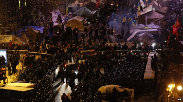 Riot policemen block Pro-European Union activists camping out in their tents on the Independence Square in Kiev, Ukraine, Wednesday, Dec. 11, 2013
