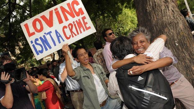 Indian gay activists celebrate the New Delhi High Court ruling decriminalising gay sex, in New Delhi on July 2, 2009.