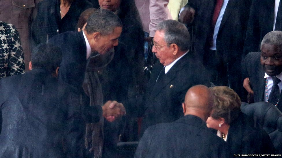 US President Barack Obama (left) shakes hands with Cuban President Raul Castro during the official memorial service for former South African President Nelson Mandela at FNB Stadium in Johannesburg, South Africa, 10 December 2013