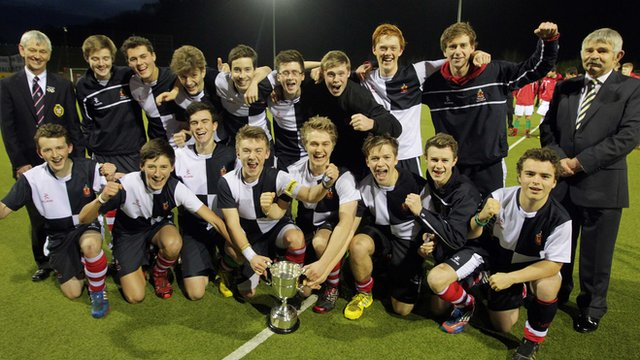 Wallace players celebrate after winning the 2013 McCullough Cup final