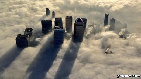 Canary Wharf in fog, photographed by a Met Police helicopter