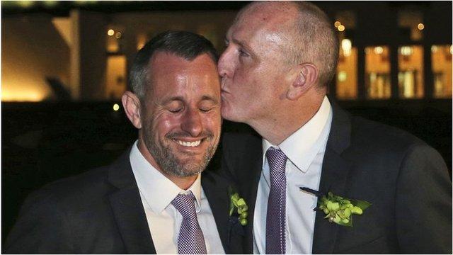 Western Australian politician Stephen Dawson, right, gives his husband Dennis Liddelow a kiss