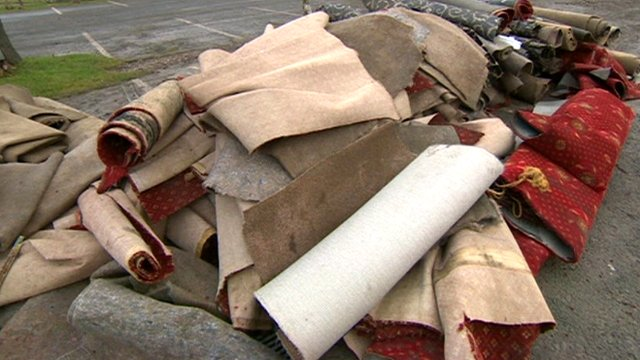 Discarded carpets after flooding in Barton-upon-Humber
