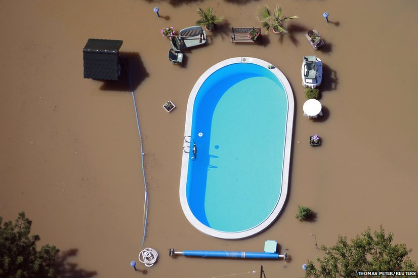 A garden with a swimming pool inundated by the waters of the Elbe river during floods near Magdeburg, 10 June