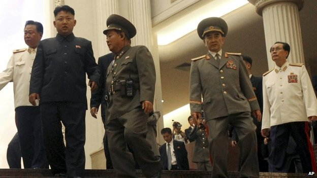 """North Korean leader Kim Jong Un, second left, flanked by Yang Hyong Sop, second right, vice president of the Presidium of North Korea""""s parliament, his uncle Jang Song Thaek, right, and Choe Ryong Hae, vice Marshal, left, as he tours the newly opened Fatherland Liberation War Museum, Saturday, July 27, 2013 as part of celebrations for the 60th anniversary of the Korean War armistice in Pyongyang, North Korea. (AP Photo/Wong Maye-E)"""