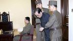 Jang Song Thaek, with his hands tied with a rope, is dragged into the court by uniformed personnel December 12, 2013 in this picture published in Rodong Sinmun December 13, 2013 and released by Yonhap