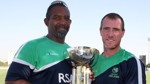 Ireland coach Phil Simmons and man of the match John Mooney hold the Intercontinental Cup trophy after their win over Afghanistan