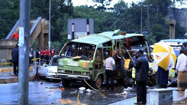 Damaged vehicles are seen at the scene of a blast near Pangani Police Station in Kenya's capital Nairobi, December 14, 2013.