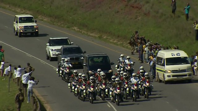 Hearse with motorcycle escort