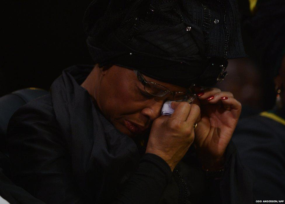 The widow of Nelson Mandela Graca Machel wipes her tears