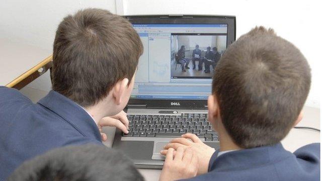 School children using computer