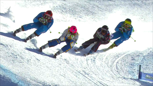 Skiers race at the Val Thorens Ski Cross