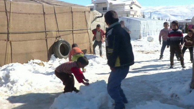 Syrian children playing in the snow at Arsal refugee camp
