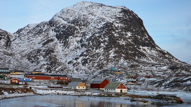 Coloured houses cluster at the foot of Qaaqarsuaq, or 'Big Mountain'