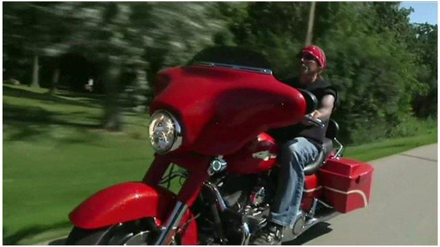 A man rides a Harley-Davidson