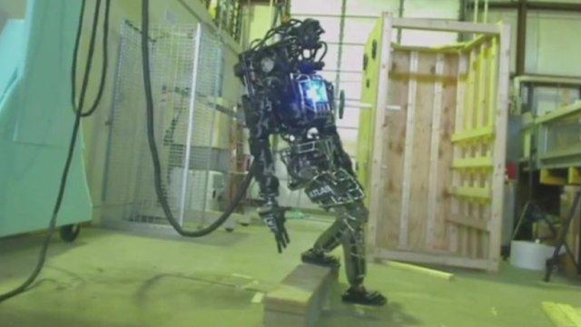 Atlas robot stumbles on concrete block test