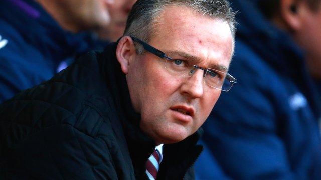 Paul Lambert watches his Aston Villa side suffering a 2-1 defeat at Stoke City