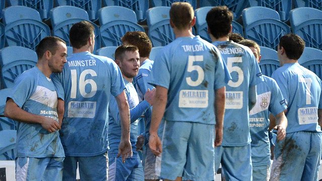 Ballymena United players celebrate David Cushley's goal against Crusaders at The Showgrounds