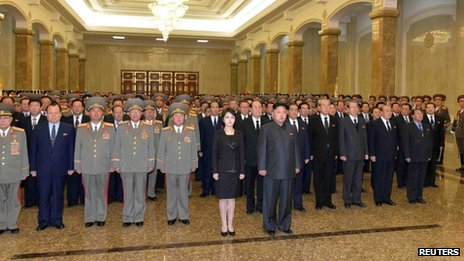 North Korean leader Kim Jong-un (centre, right) and his wife Ri Sol-ju (centre, left) visit the mausoleum of his father and former leader Kim Jong-il and his grandfather and state founder Kim Il-sung, during a ceremony marking the second anniversary of the death of Kim Jong-il in Pyongyang, 17 December 2013