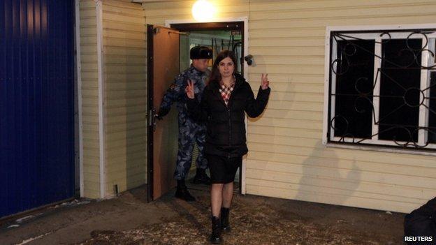 Nadezhda Tolokonnikova gestures as she walks out of prison in Krasnoyarsk