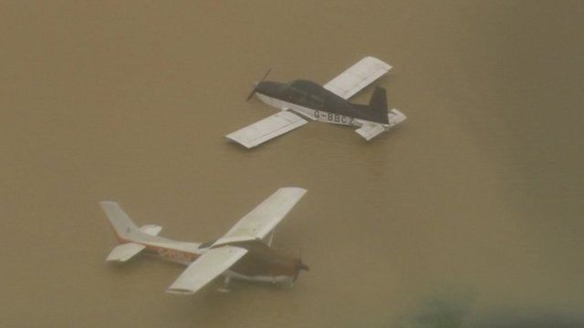Aircraft in flood water at Redhill Aerodrome, Surrey