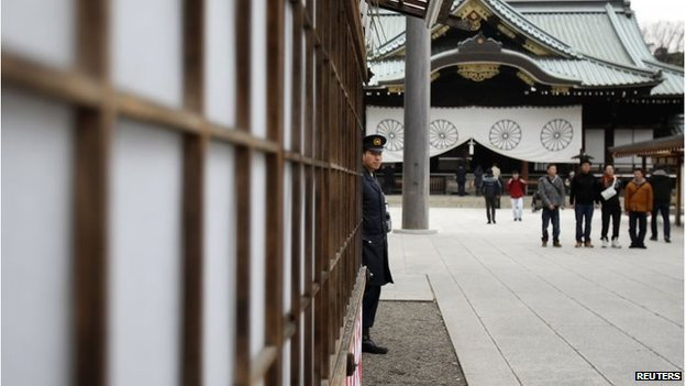 A policeman stands guard at Yasukuni Shrine in Tokyo December 26