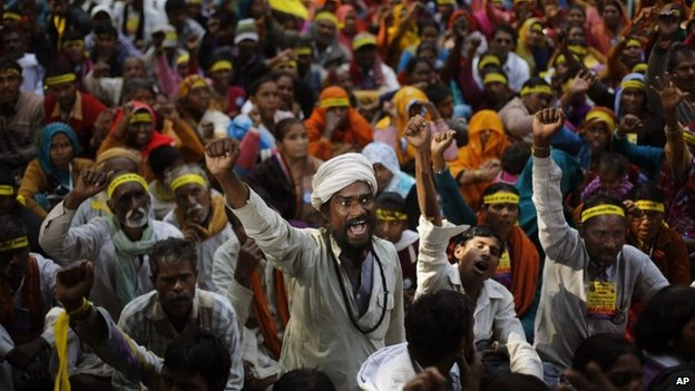 Indian Dalits, or untouchables, shout slogans demanding equal growth opportunities in Delhi, India, Friday, Dec 6, 2013