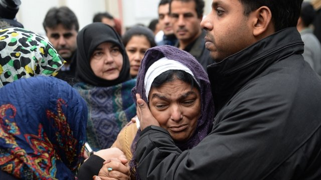 Fatima Khan comforted by mourners