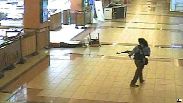 This screen grab released on Ocotber 18, 2013 and taken from closed circuit television shows an armed man walking during the attack at the Westgate mall in Nairobi on September 21, 2013.