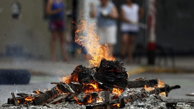A fire lit by a protester